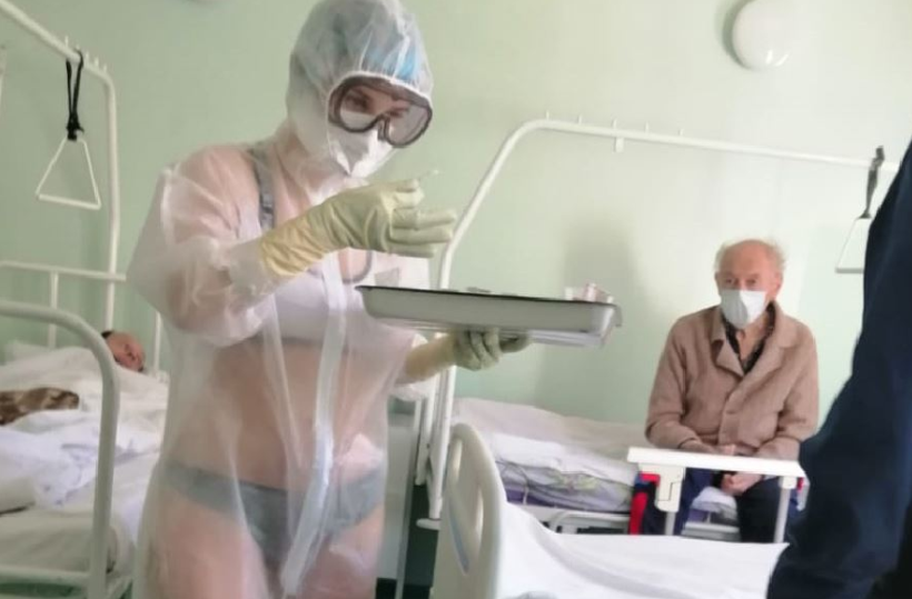 Nurse Treating COVID-19 Patients Goes Viral For Wearing Only 'Lingerie' Under Transparent PPE Gown In Male Hospital Ward (Photos)